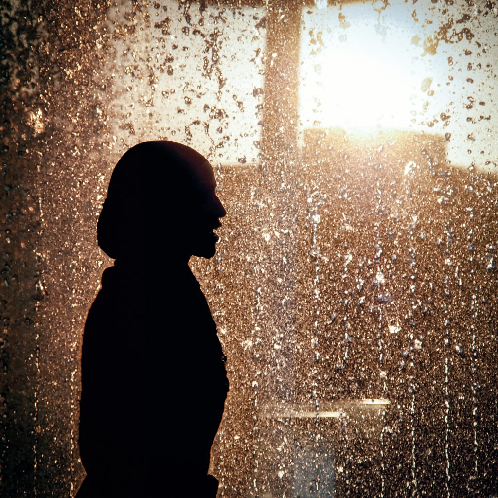 Picture of woman silhouetted against a fountain