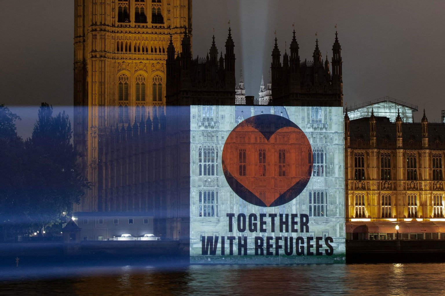 Orange heart projected on House of Commons